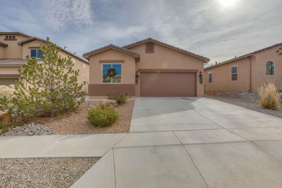 This beautiful home lies in a great neighborhood that is conveniently located for a quick commute in Albuquerque or Rio Rancho! It is an open floor plan with a split bedroom concept to give the master some space from the other rooms. The kitchen boasts SS appliances, including a refrigerator & a gas stove, for those who know an electric just won't do! There are plenty of cabinets & counter space, a huge dine-at island & a pantry to provide plenty of storage.  The master suite features a beautiful bathroom with a garden tub, double sinks & a separate shower, plus a walk-in closet! It is energy efficient  with a silver rating! It has refrigerated air & comes with the washer & dryer.  Just blocks from a park that has a water area, playground & picnic area & it's near the new sports complex!