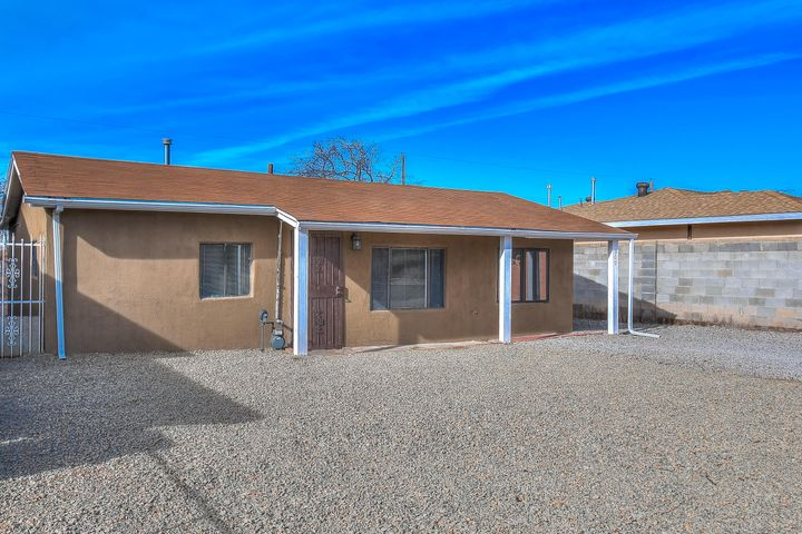 Great opportunity to own this beautifully remodeled home conveniently located in the North East side of Albuquerque. This home features two bedrooms and two bathrooms, open concept includes Quartz counter tops, stainless steel appliances, beautiful back splash in the kitchen and master bathroom areas. Tile matches throughout the home. Large front and back yards with Sandia Mountain views. Come see this home today, At this low price and with its awesome features it won't last!!! Please see LO/SO remarks