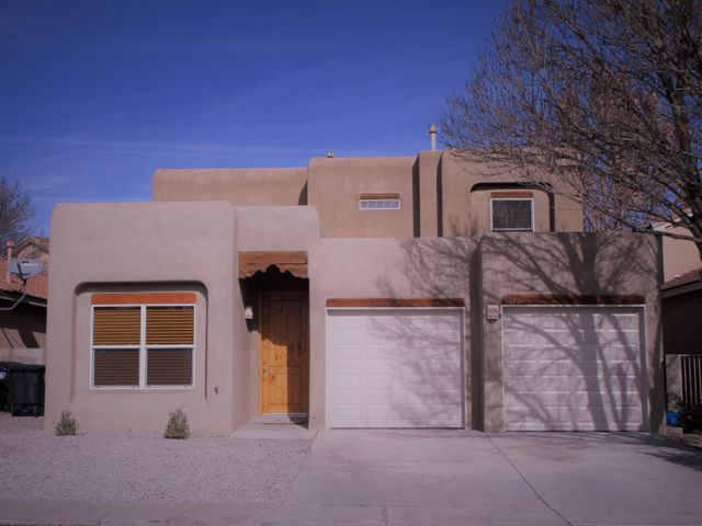 Gorgeous Southwestern Style Home by Tiffany Homes.  Fresh Paint, New Carpet, and Stainless Appliances.  Master Bedroom downstairs, with amazing on suite. Double vanities, separate tub and shower.  Two additional bedrooms upstairs plus loft.  Bright and open living room features kiva fireplace, high ceilings.  Breathtaking backyard has easy to care for with artificial turf and outdoor kiva fireplace, plus large covered patio.