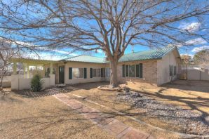 One of a kind opportunity in the heart of Rio Rancho!  This unique home sits on a HUGE corner lot and has upgrades throughout!  Remodeled kitchen, bathrooms, flooring, and windows are just a few of the newer updates!  Open concept floorplan with upgraded kitchen cabinets and appliances.  Front porch has been enclosed and creates a dramatic entry with endless possibilities.  Large storage room attached to home.  Extended concrete RV pad with beautiful  iron gates and side yard access.  Inground gunite pool with waterfall and HUGE outdoor covered patio situated on this nearly .40, fully walled and fully landscaped lot!  4 carport spaces, refrigerated air, no HOA, and plenty of room for your toys!  Schedule your private showing today!