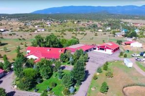 **$10,000 BONUS to Buyer's Agent**Just 15 minutes east from the heart of Albuquerque Metro!  RECENT MAI APPRAISAL $1.7M. Magnificent Country Estate perfect for CAR COLLECTORS, HORSE LOVERS, BEDnBREAKFAST. Private and serene 6.13 LUSH Park-like Acres, Pipe Fenced, Emerald Green Lawns. Panoramic Views. Close to Snow Skiing, Golfing at Pa'ako, and a short drive to Santa Fe via the Turquoise Trail. Custom 4,094 sq ft home, 1,965 sq ft Guest House, Covered Patios, Outdoor Kitchen, 2,500 sq ft. Finished Garage with 1/2 Bath ---ready for your Collector Cars and Toys. PLUS----4 Car Enclosed Portico and an additional 3 Car Garage.  4,000 sq. ft Barn for the horses with ample room for an arena.  Owner will consider REC or possible Trade