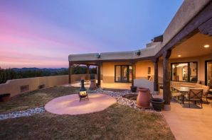 Beautiful single story custom by Home by Marie! Your own private retreat from the world in gated Nature Pointe community w/access to clubhouse, indoor pool, & gym just a 2 min walk! Charming courtyard welcomes you to this lovely SW design w/great room at the center of the home w/wall of windows viewing rear patio & treed lot. Vigas! T&G ceiling. Elegant, open kitchen w/granite counters, breakfast bar, custom cabinets, stainless appliances & gas stove.  Formal dining is a lovely place to entertain w/views to the rear patio & yard. Split master offers privacy from other bdrms.  Master is a cozy spot to rest and rejuvenate w/frplc , patio access, & luxury bath w/double sink, sep shower & deep tub.  2 bdrms have private baths & walk-in closets.  Solar panels give you virtually free electricity