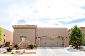 Come see this Stunning single-story custom home with elegant upgrades & amenities. It's in a desirable gated community in the heart of the North Valley! This home features an open floor plan with 10' ceilings, plaster wall finishes, custom alder doors, skylights & stacked stone gas FP. Kitchen has custom cabinets, granite countertops, SS appliances, pantry & breakfast bar. There are wood floors throughout with tile in bathrooms & laundry room. The Two Master Suites each have a master bath. Laundry room has custom cabinets, granite countertops & a sink. High Efficiency Combo Unit/Refrigerated Air. 2''X6'' exterior walls including the garage. Pre-wired for security system & smart home. Lovely private quiet courtyard leading to the beautifully landscaped backyard with a water feature. Come se