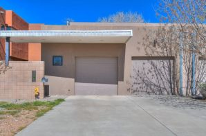 Welcome to this beautiful home in the desirable Albuquerque Country Club neighborhood. This contemporary home is a modern master piece with multiple living spaces, three courtyards for entertaining and vaulted ceilings. The master bedroom is located downstairs and the other bedrooms are large for comfortable living. This home is beautifully constructed with Pella windows, granite countertops and stained concrete floors for perfect urban living. Don't miss your opportunity to own a piece of real estate just down the street from the ACC and close to Old Town and restaurants. The seller is motivated and looking at ALL offers.
