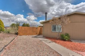 Lovely and updated in the heart of Rio Rancho!  This 2 bedroom 1 bathroom home has been updated throughout to include a remodeled kitchen and bathroom, updated windows, fresh paint, and no carpet!   Large living room with fireplace and open concept floorplan.  Located on a HUGE lot with spectacular mountain views.  Refrigerator, washer, and dryer included!  Home has two large exterior storage closets.   Back yard vehicle access!  Schedule your private showing today!