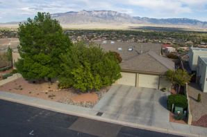 Best views in entire market! Privacy abounds in this quiet Luxury gated community close to work, dining, shopping etc! Lovingly cared for one owner custom home situated on bluff overlooking Corrales. World class 180 degree views of Sandia Mountains, Balloon Fiesta, Rio Grande Bosque, fireworks show, city lights.Spacious single story with open floor plan concept. Luxury kitchen featuring granite counters, stainless steel appliances, wine cooler etc. No carpet, new wood flooring in living room and bedrooms. Beautiful mature trees with stunning front courtyard. Built in grill station, large covered patio to enjoy the views. Putting green and garden area too! New furnace, A/C and water heater in last 2 yrs. Custom paint throughout. This is a cream puff! A must see!