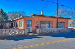 This beautiful New Mexican home is located only walking distance away from the Iconic and Historic Albuquerque Old Town. Offering classic New Mexican architecture this home was built in 1901, marking itself as a centennial home. Having undergone renovations to modernize the home it offers plenty of interior space, two fireplaces, up to 4 car port, a huge lot, and of course historical New Mexican charm. To the keen eyed investor, or lover of New Mexican architecture this home offers a fantastic opportunity to own a piece of standing history in one of the most popular areas of Albuquerque. Don't miss out on the opportunity to invest in a part of New Mexican culture, Schedule a showing to this beautiful home today!