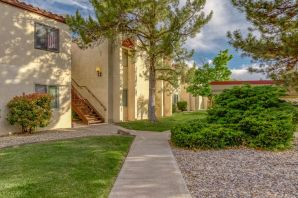 Great Condo in Rio Rancho with tons of upgrades. The Kitchen features updated stove, refrigerator, countertops and painted cabinets. Bathrooms have all upgraded sinks, and toilets, and whole condo features upgraded wood laminate flooring and light fixtures! The covered patio gives a great view of the community pool and grass common area, and is a great spot for entertaining.