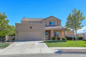 Fantastic home in Rio Rancho has been beautifully maintained and updated.  The kitchen has granite countertops, tile backsplash, stainless steel appliances and 18'' tile flooring. The kitchen is open to the sunken living room which has a custom stone fireplace. The views from the balcony off the master bedroom are amazing.  Enjoy BBQ's in the beautiful backyard with a pergola, water feature and deck to look at the views of the Sandia Mountains. Price Reduced below market value for a quick sale!