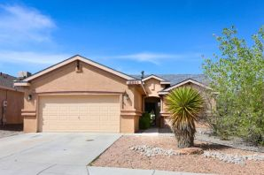 Lovely single level Pulte Home located in Ventana Ranch!  2019 NEW WOOD LAMINATE FLOORS;  2018 NEW ROOF, DISH WASHER & MICROWAVE; 2016 NEW STOVE;  2015 NEW TILE in LIVING ROOM.  WOW! Seller gets a $2500 credit for the kitchen cabinets @ close! Arched Doorways; Large Kitchen with Island,  Built-In Entertainment Niches. Separated Master Bed Room with Walk-In Closet & Master Bath Room with Large Shower. Large Backyard with Covered Patio and View of the Sandia's. Easy Care Landscaping and Alarm System.