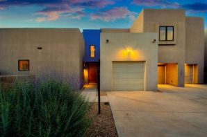 Contemporary masterpiece built to the highest level of perfection by Wilder! Located off of Rio Grande in the Villas Las Mananitas community! Home features a rich palette of the finest finishes including oxidized copper lighting by Santa Fe artist Michael Landcaster!  Stylish living area with stained concrete floors, surround sound, wet bar and gas fireplace! Designer kitchen with high-end birch cabinetry, concrete countertops, backsplash, commercial grade range w/ 6 burner cooktop, dual dishwasher, copper sink, and a large island! 1st floor master w/ outside access and a private bath! Bath hosts dual vessel sinks, custom vanity and a walk-in shower with dual heads! Quiet upstairs office w/ birch bookshelves & a private balcony. 2nd master suite with bath! Finished garage w/ over 900sf!