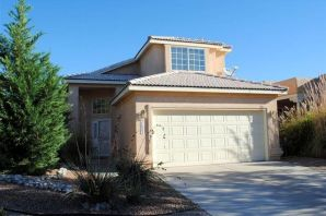 Fabulous location in Palomas Park close to Paseo Del Norte/I-25 corridor. Enter through the foyer and find a wonderful curved stairway leading to the upstairs living quarters. This light & bright home has wood floors in living room, dining room and family room. The master bedroom with a large balcony offers wonderful mountain VIEWS! In this home you will find high ceilings drenched with sunlight throughout. Wonderful neighborhood with lush park just steps from this darling home.