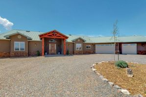 Stylish Modern Mountain Nature Pointe retreat just 2 years old and NM Green Gold certified. Spacious & bright, one story with 5 bedrooms, 3 en-suite bathrooms plus 2 additional bathrooms. Large open concept living & dining overlooks the back patio & forever views. Gourmet kitchen with 48'' Jenn-Air dual convection oven, large island for entertaining, wine fridge and pot-filler over stove & in Butler's Pantry. Stunning master suite boasts walk-in shower w/3 shower heads, separate soaking tub & huge master closet w/separate washer & dryer. Second living room wing can be closed off for separate MIL Quarters. Oversized 1250SF 4 car attached garage w/dog wash & drive-thru doors. 400SF rooftop deck w/360 views! Community pool, clubhouse & ammenities. See the 3D Tour & Additional Features Page.