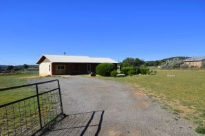 Wonderful 3 bed 2 bath home nestled on a 2 acre fully fenced lot. Open kitchen, dining and living area featuring a freestanding wood burning stove to warm up those wintry nights! Enjoy the summer evenings on the outdoor covered back patio. Only 20 mins from ABQ!