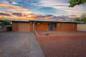 This is a jewel in the North UNM campus area. Contemporary open floor plan in this high end 3-4 bedroom single level home. Granite counters with SS appliances. Home gutted and redone in 2006. Refrigerated air. Large master suite added with contemporary master bath including garden tub and walk in closet. Living room has floor to ceiling windows bringing in lots of light plus a cozy fireplace. Covered patio with ceiling fan off dining room for outdoor grilling. Small lawn area & a shed on this wide lot. Security system. Single car garage and a separate laundry room South wing has two bedrooms sharing a bathroom plus office. Home sits across from the UNM North golf course with walking trails. Area is dog & bike friendly. Walk or bike to UNM campus, Law School and hospital.LO/SO Remarks:
