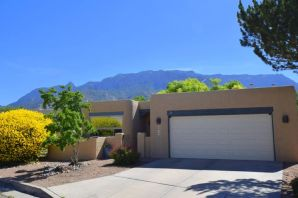 OPEN HOUSE Sunday, June 16 from 2-4PM. Stop by and check out the conveniently located home with views of  the Sandia Mountains. Roger Smith built this open floor plan, single story home with a kiva fireplace on a cul-de-sac. Master bedroom has walk in closet, separate shower and tub, plus a walk-out to a patio.  The kitchen boasts granite counter tops, newer back-splash, and sink. The bathrooms have been remodeled. A few newer items are: insulated garage door, office garden landscaping, exterior paint, water heater, windows, doors, wood flooring, interior paint. Enjoy the nearby Tramway walking trails. Make this home yours today!!