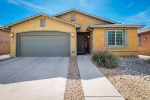 Welcome to this beautiful home located in the Jubilee Active Adult Community which was recently recognized this June as one of the 50 best Master Planned Communities in the US! This 1715 SF home has 2 x 6 Construction, 2 BR's, plus an office/den w/French Doors, 2 BA's, 2 CG and a  custom landscaped backyard w/covered patio, water feature and nice views of El Cerro de Los Lunas Preserve (from the SE corner of the backyard).  Original owners have meticulously maintained the home. Kitchen is open to the living area and has granite counter-tops, nice cabinets with plenty of storage!  All Appliances Stay including W&D! REF AIR!  You will enjoy the 11,000SF Clubhouse which has a huge gym, Jr size Olympic pool, daily activities, billiards, etc! Jubilee is located about 20 minutes south of ABQ!