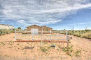 Fantastic 5 bedroom home in desirable Rio Rancho on 1/2 acre lot. Enjoy this open floor plan with lots of light open and bright. Big remodeled kitchen and baths all updated. Laminate floors and new carpet. Back yard access. Don't miss this one.