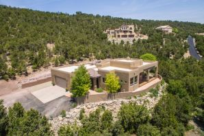 Resort style living in the mountains with incredible views on approx 3.25 acres in Sandia Mountain Ranch!! Custom elegance featuring TPO Roof, Refrig Air, Sec System, Water Softener, Skylights, Private Elec Gate.  Amazing outdoor living space featuring a huge raised deck for entertaining, relaxing in nature taking in the mountain views!  Great room features wall of windows, wood beam ceiling, wood stove. Custom kitchen features cherry cabs, granite countertops, walk-in pantry, bkfst bar & nook.  Master suite features his/her vanities, jetted tub, sep shower, two walk-in closets.  Finished & insulated oversized 2CG!