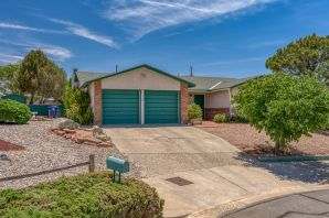 Welcome to this charming 3 bedroom home featuring 2 tiled baths plus 2 living areas.  New roof and Master Cool in 2017.  Frigidaire appliances.  Spacious backyard with lots of potential! Covered patio and 2 storage sheds. La Cueva district. Home sweet home!