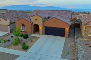 Imagine going to sleep in the master bedroom watching the twinkling city lights and waking to view hot air ballons with the beautiful mountains in the background!  If you've been waiting for that PERFECT HOME, here it is!! This gorgeous 2 year old home was built on a PREMIUM VIEW LOT and has PANORAMIC VIEWS OF THE CITY, SANDIA'S AND MONZANO MOUNTAINS!! Views are from the kitchen, dining, living room and master suite and will never be obstructed!! Home is 2035sf ''The Preserve'' model and has TWO MASTER SUITES, 2.5 baths, an office, a beautiful kitchen with gorgeous granite, gas cooktop and all SS appliances which stay incl the W/D!! 2 Car Garage has extra storage space!!  This is a 55+ Active Adult Community at Del Webb Mirehaven and has an Amenity Center with pool,gym & daily activities!