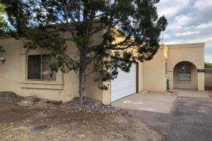 Charming home nestled in Rio Rancho's North Hills.  Conveniently located near schools and numerous parks.  Clean home with new carpet to be installed after buyer chooses color.   Wall surrounding yard will have have stucco replaced when buyer chooses exact color wanted.  Could this be your new home?