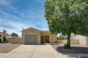 This open and bright home hosts newer carpet and paint with huge back yard perfect for entertaining.  In highly desired Rio Rancho neighborhood with updated master bathroom and newer roof.  The exterior has brand new beautiful paint job, making this house ready for move in!  Close to parks, walking trails, and shopping.  Must See, will go fast!!