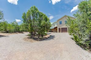 Lovely and quiet Sandia Mountain Ranch property. 5 bedroom, 3 bathroom home nestled on 3.3 acres. Beautiful open floor plan with large windows everywhere to take in the scenery. Sitting area in master bedroom to take in amazing views and sunrises. Kitchen has all Electrolux appliances that convey. New boiler unit in 2016, new 80 gallon water heater in 2019. RV parking with dump tank at the south end of the driveway. The backyard is completely fenced in and suitable for whatever pets you have.