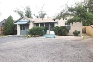 Just minutes away from UNM Campus in the Nob Hill area. This unique home has 4 bedrooms. The 4th bedroom can be used as a Studio/Office/Workshop with a separate entrance from the street.  2 enclosed porches one in front and  large enclosed porch in the fenced backyard. Breakfast nook off the kitchen and you will also find a formal dining area. In the spacious living room is the original  hearth surrounding the wood burning fireplace. Included is several built in bookcases. New roof with a 5 yr labor warranty and a 30 yr manufacture shingle warranty. Newer double pane vinyl windows /50 gallon water heater. A 220 electric drop for future use if needed for refrigerated air. Parking for up to 4 vehicles comfortably.