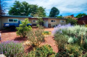 Just steps from a cute city park, this single-story mid-century home features updates in the kitchen and baths.  The large master bedroom is separate from the other three bedrooms and adjacent to the den.  The large yard with open patio is perfect for entertaining.  Refrigerated air.