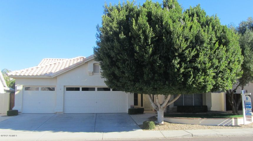 LUSH LANDSCAPE, NORTH SOUTH EXPOSURE, LARGE LOT AND 3 CAR GARAGE!