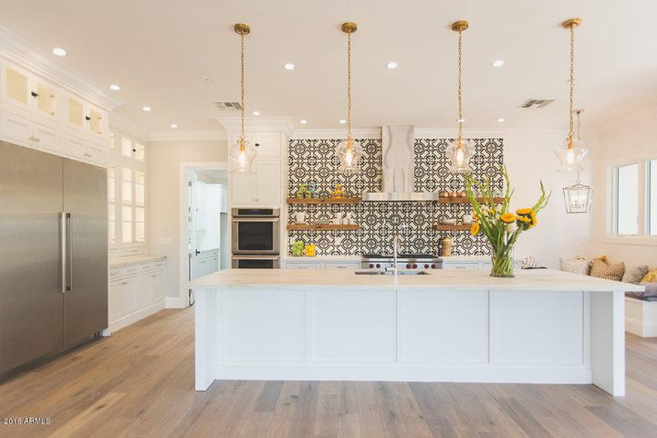Bright Kitchen Opens To Living And Dining Spaces. Features Wolf And  Thermador Appliance And A