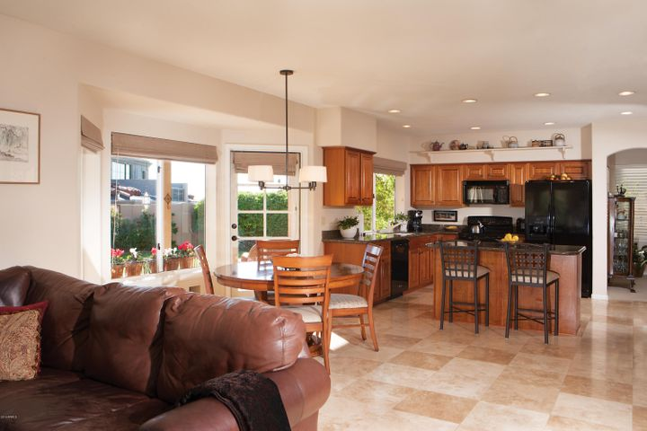 The perfect spot to gather with a large eating area and a kitchen island with it's inviting bar seating.