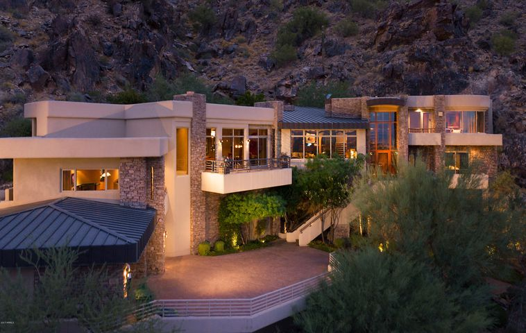 """Built in 1998 by Salcito Homes, and located in the esteemed guard-gated community of La Place du Sommet, 5676 E. Cheney Drive is a trophy 1.51 acres, dramatically sited Paradise Valley real estate—an estate for those that want """"extraordinary""""."""