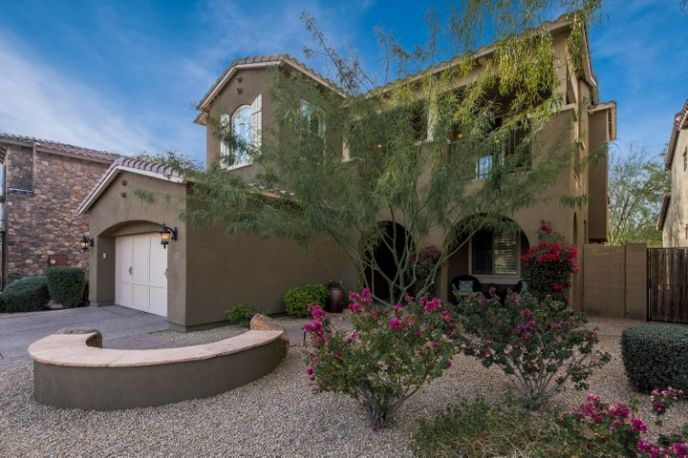 Stunning curb appeal with mature landscaping.