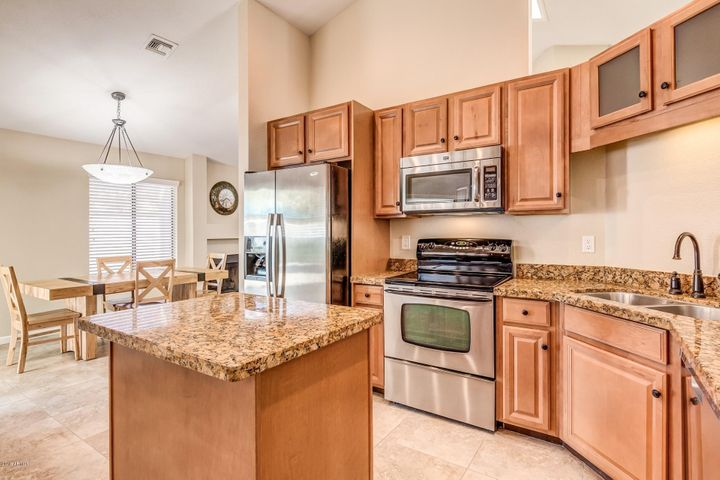 Kitchen with newer custom cabinets and granite counters