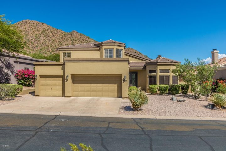 Mountain views & desert wash in back; desert wash in front. No neighbors directly behind or in front of you!