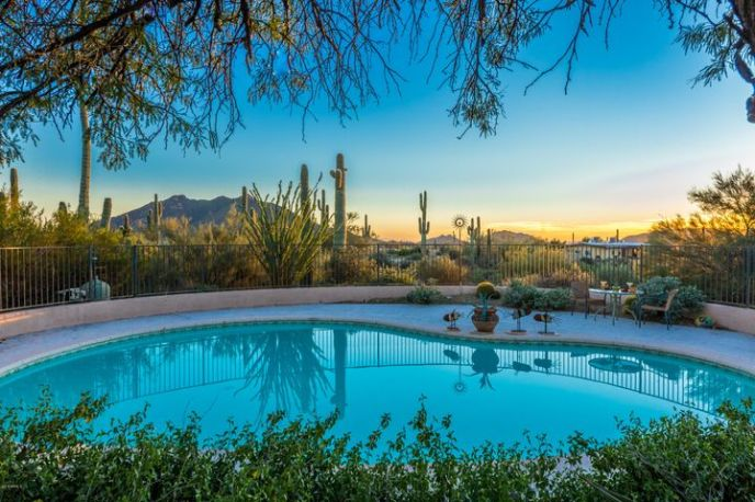 Enjoy mountain views and sunsets from your pool deck.