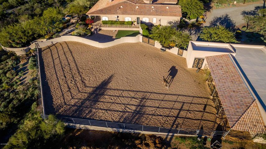 Level arena great for dressage. Also room available to expand the arena size. The stables are double size, have storage rooms and turn-out pens. Nearby access to trails also!