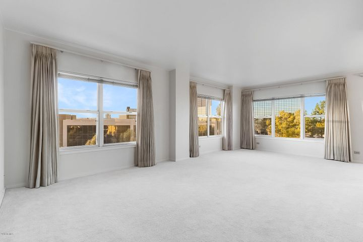 Spacious living room with two exposures and city views.
