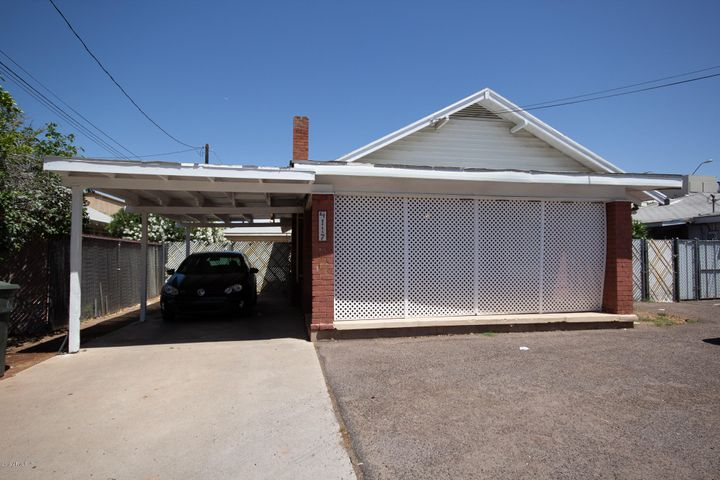 Carport & Access to garage in the rear - room for 8 cars - fully A/C