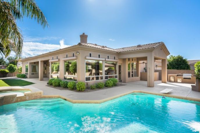 Large wrap around pool and spa with double patios and separate BBQ and fire place sitting area
