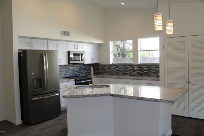 New Cabinets, granite counter tops, sink, faucet, appliances and lighting.
