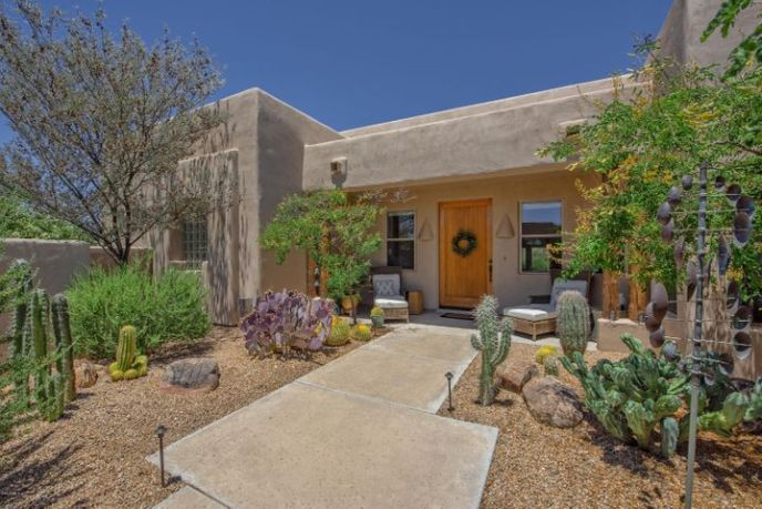 Charming courtyard entrance with views of black mountain