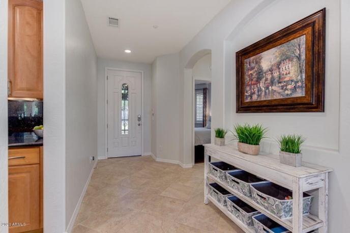 Glass Door Entry Allows Natural Lighting.