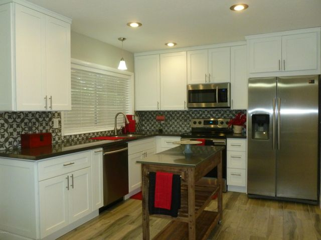 This Stunning kitchen is waiting for a new home chef and the pictured appliances are included