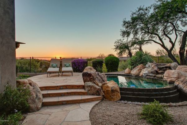 Gorgeous sunsets with private backyard that overlooks expansive wash