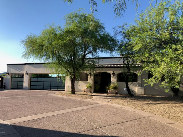 Front of home with 3 car garage