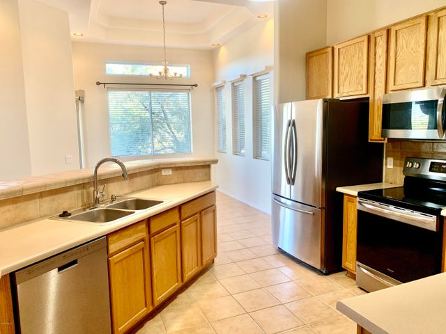 Beautiful kitchen with stainless steel appliances, tons of cabinets and counter top space