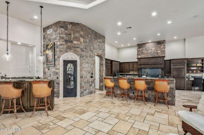 Kitchen and great room have island seating, wet bar for entertaining